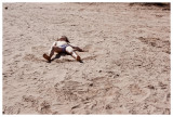 Giddy Norah doing sand angels