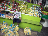 Boy At Fruit And Vegetable Stand