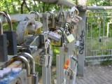 love locks on a pedestrian bridge high over a roadway in Misky Sad park