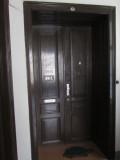 the door to Herb's former flat