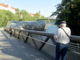 at the Murinsel, a floating bridge artwork...