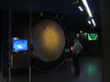Tom checks out a gigantic drum...
