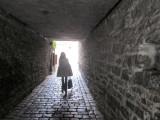 thru a stone passageway...