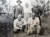 a family group with her grandparents, and at front right her father František Polívka