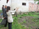 now we're behind that garden in a courtyard where many more stones were found...