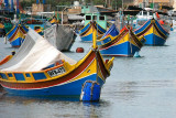 ...with a harbour packed with luzzu, the traditional fishing boats.