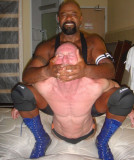 pro wrestling black musclebear manhandling beating white dad.jpg