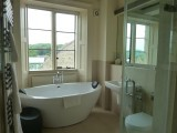 with open plan bathroom - the walls stop short of the ceiling