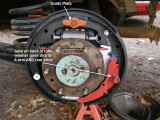 put guide on anchor. place SA arm with pivot on rear shoe with nail, tube washer & straight spring