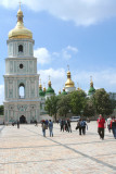 People strolling in front of the bell tower of Saint Sophia Cathedral.