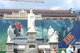 Sculptures of the Holy Ancestors in front of a jeans billboard (near St. Michaels Cathedral).