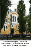 Saint Volodymyr's Cathedral (1862-1882) as seen from across the street through the trees.