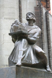 Close-up of the sculpture of Yaroslav the Wise. He is holding a model of Saint Sofia Cathedral.