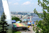 Looking at Peoples' Friendship Monument from a hill with the Dnieper River in the background.
