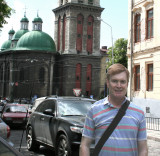 Me in front of the Kornyak Tower and the Assumption Church (about to be run over)!