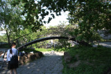 Hunch-backed wooden bridge at the Old Odessa in miniature park.