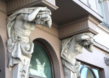Close-up shot of another building with cariatides.