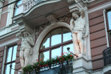 View of a beautiful Lviv building with cariatides.
