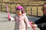 This cute Chinese girl was making bubbles at entrance of the Temple of Heaven in Beijing.