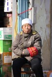 The woman wore an armband with Chinese writing.