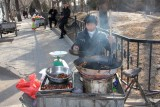 Vendor roasting chestnuts near the Summer Palace in Beijing.