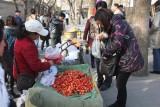 Woman buying fresh strawberries.