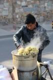 Vendor steaming ears of corn in Beijing.