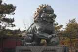 Male bronze lion guarding the Gate of Dispelling Clouds at the Summer Palace.