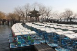 Small tourist boats docked at Kunming Lake.  They were not in service yet, since it was March.