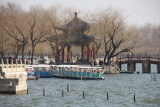 Tourist boats with the Knowing Spring Pavilion in the background.