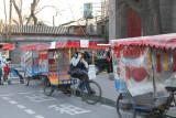 Rickshaws for hire on a Beijing street.