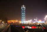 It is a three-sided tower that changes colors at night. It was built for the 2008 Olympics.