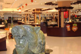 The jade shop with a lion sculpture roaring in the foreground.