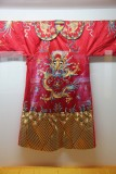 Red silk garment with a dragon, worn by emperors and the aristocracy.