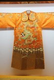 A similar yellow silk garment with a dragon.