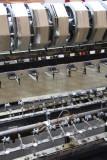Close-up of the threading machine.