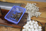 Silk cocoons and silkworms.  After the worms are removed, they are eaten (not by me, thank you)!