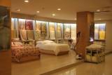 Silk bedspreads on display in the showroom.