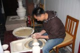 Chinese artisan demonstrating how to make a vase.