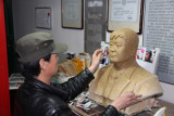 Another artisan making a life-like sculpture.  For the right price, he would have made one of me!