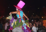 A woman on stilts wore a pink Cat in the Hat hat.