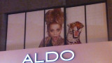 An advertisement for Aldo. The model looked as wild as the leopard!