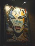A modern art mural of a woman.