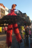 Another woman on stilts who looked like she worked in a bordello!