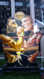 Depiction of the President of Iran, Ahmadinejad, in an arm wrestling contest.