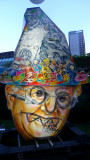 Another Dick Cheney look-alike with cartoon characters on his hat.