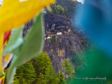 Tiger's Nest coddled in prayer flags