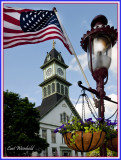 Lamp post flag and flower baskets