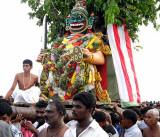 A new head of Simhamukha, the lion-faced demon, is fixed on the asura`s body. Skanda Sashti at Tiruchendur.
