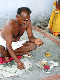 The shaman throws cowrie shells to find out what to do. Tirunelveli District, Tamil Nadu.